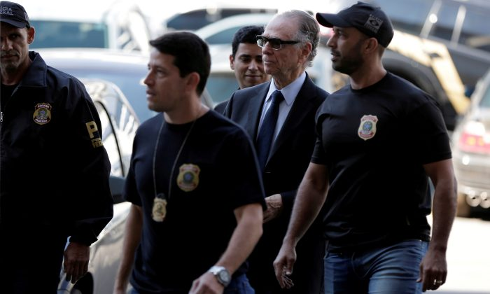 Brazilian Olympic Committee (COB) President Carlos Arthur Nuzman arrives to Federal Police headquarters in Rio de Janeiro, Brazil, on Oct. 5, 2017. (REUTERS/Bruno Kelly/File Photo)