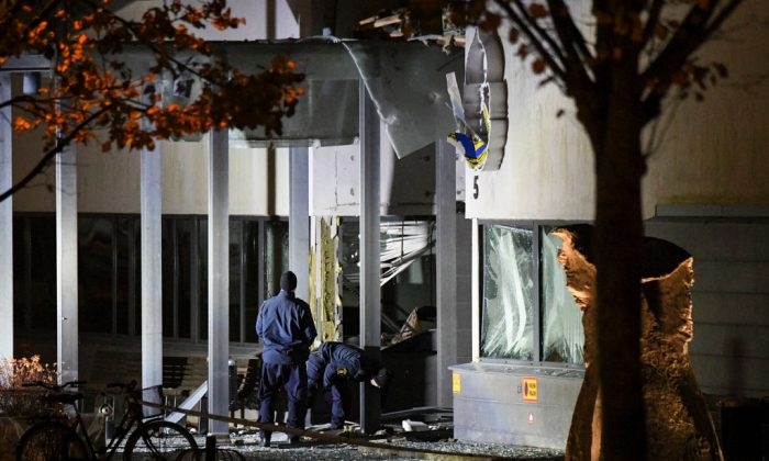 Police forensics work outside the police station in Helsingborg, on Oct. 18, 2017, after a powerful explosion occurred at the main entrance. (Johan Nilsson/AFP/Getty Images)