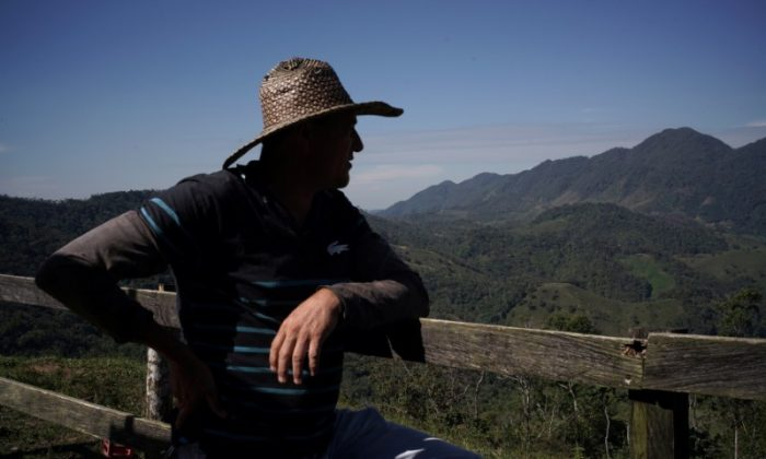 Libardo Garcia, a farmer who was displaced during the terrorist violence and returned to grow coffee with his family, looks out in San Carlos, Colombia July 13, 2017. (REUTERS/Federico Rios)