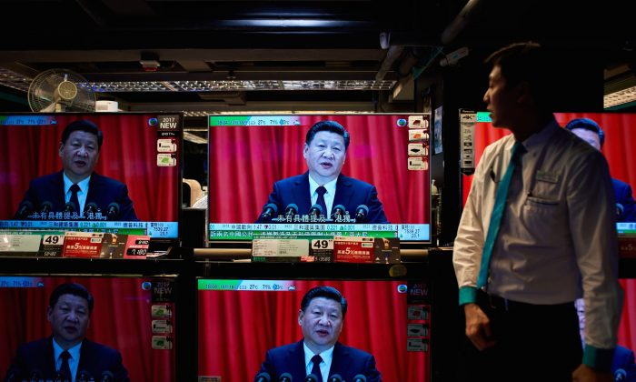 An electronics shop in Hong Kong with television sets showing a news report on Xi Jinping's speech at the opening session of the Chinese Communist Party's 19th National Congress, on October 18, 2017. (Anthony Wallace/AFP/Getty Images)