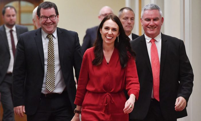 New Zealand Prime Minister Jacinda Ardern (C) arrives at a press conference with MPs Kelvin Davis (R) and Craig Robertson at Parliament in Wellington on Oct. 19, 2017.(MARTY MELVILLE/AFP/Getty Images)