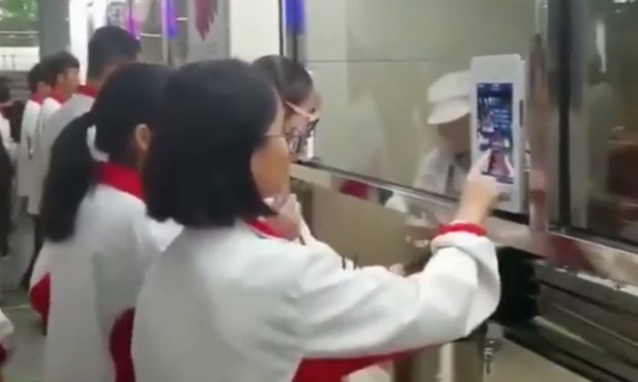 A High School in China now subjects students to facial recognition before they could be served lunch in the cafeteria. (Screenshot from Youku video/Epoch Times)