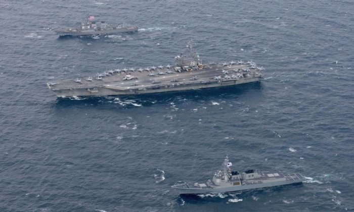 The Navy's forward-deployed aircraft carrier USS Ronald Reagan and the forward-deployed Arleigh Burke-class destroyer USS Stethem steam alongside ships from the Republic of Korea Navy in the waters east of the Korean Peninsula on Oct. 18, 2017. (Courtesy Kenneth Abbate/U.S. Navy/Handout via REUTERS)