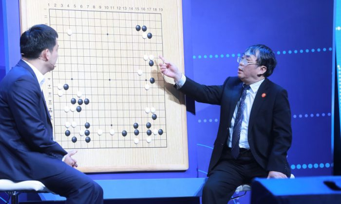 Experts review moves during the Go match between 19-year-old Ke Jie and Google's artificial intelligence program AlphaGo in Wuzhen, in eastern China's Zhejiang Province on May 27, 2017.  (STR/AFP/Getty Images)