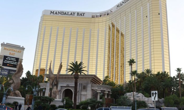 Police stand near the The Mandalay Bay Hotel and Casino in Las Vegas, Nevada, on October 4, 2017 before the windows Stephen Paddock broke for his shooting spree were repaired. (ROBYN BECK/AFP/Getty Images)