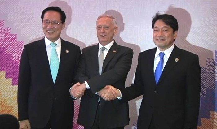 U.S. Defense Secretary Jim Mattis (C) joins hands with his South Korean counterpart Song Young-moo (L) and Japanese counterpart Itsunori Onodera in the Philippines' Clark special economic zone on Oct. 23, 2017. (Video screenshot/Reuters)