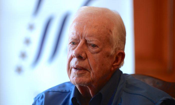 Former U.S. President Jimmy Carter in November 2013. (PRAKASH MATHEMA/AFP/Getty Images)