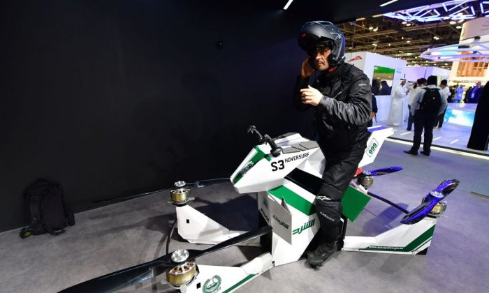 An Emirati police officer sits on a drone motorcycle at the Gitex 2017 exhibition at the Dubai World Trade Centre in Dubai on Oct.8, 2017. (Giuseppe Cacace/AFP/Getty Images)