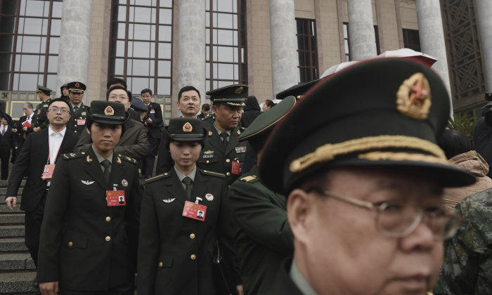 Chinese military delegates leaving the opening ceremony of the 19th National Congress after it concludes, in Beijing's Great Hall of the People on October 18, 2017. (Greg Baker/AFP/Getty Images)