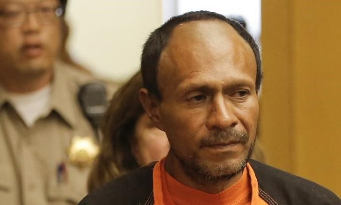 Juan Francisco Lopez-Sanchez is led into the Hall of Justice for his arraignment in San Francisco, California July 7, 2015. (Reuters/Pool/Michael Macor)