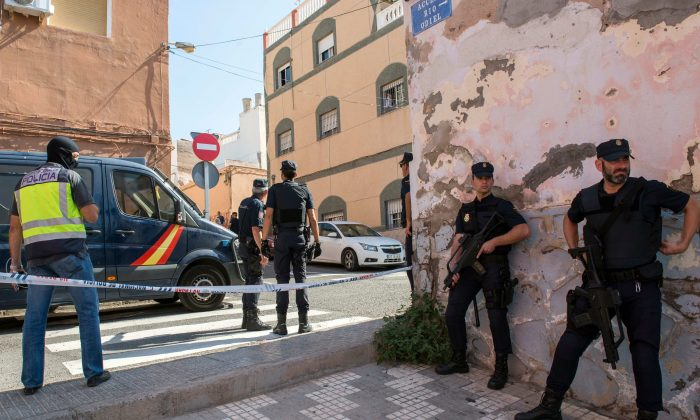 """Police officers take part in an anti-jihad operation in the Spanish enclave of Melilla, on Sept. 6, 2017. Police in Spain and Morocco have arrested six members of a suspected terror cell who were preparing """"large-scale attacks"""", officials in both countries said. (BLASCO DE AVELLANEDA/AFP/Getty Images)"""
