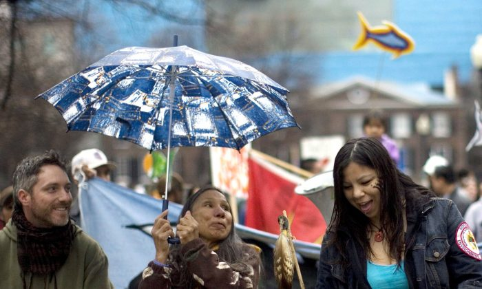 Demonstrators prepare to march during a protest in Toronto on April 7, 2010, to highlight the mercury poisoning that they claim is adversely affecting the health of the Grassy Narrows community. (The Canadian Press/Chris Young)