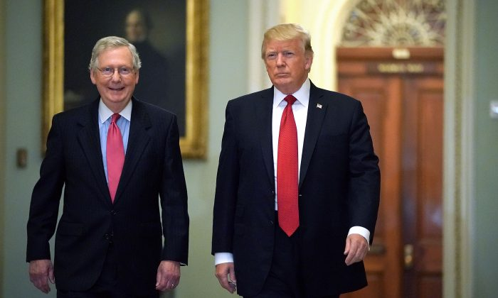 Senate Majority Leader Mitch McConnell (R-Ky.) (L) and President Donald Trump arrive for the Republican Senate Policy Luncheon at the U.S. Capitol in Washington on Oct. 24, 2017. (Chip Somodevilla/Getty Images)