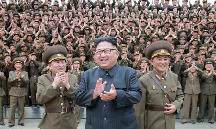 North Korean leader Kim Jong Un claps with military officers at the Command of the Strategic Force of the Korean People's Army (KPA) in an unknown location in North Korea in this undated photo released by North Korea's Korean Central News Agency (KCNA) on Aug. 15, 2017. (KCNA/via REUTERS)