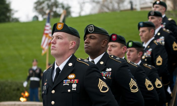 5208c06e Soldiers from each of the U.S. Army's Special Forces groups stand silent  during the wreath-