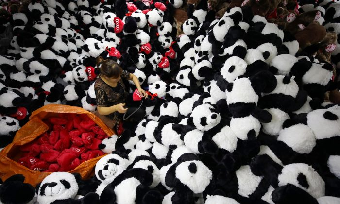 """A Chinese worker makes stuffed panda toys for export at a toy factory in Lianyungang, Jiangsu Province on Oct. 9, 2017. A recent survey placed China at the bottom of a """"Made-in-Country Index."""" (STR/AFP/Getty Images)"""