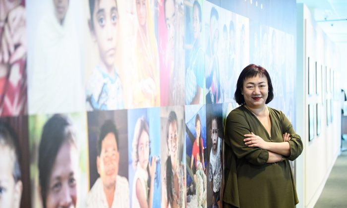 Photographer Pearl Gan at the Asia Malaria Images Exhibition. The exhibition is a joint effort by Gan. (Courtesy of Roche Diagnostics Asia Pacific Pte Ltd/ Ashley Mak Photography)