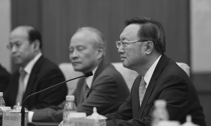 Yang Jiechi (R) during a meeting at Diaoyutai State Guesthouse in Beijing on March 18, 2017. Yang was promoted to the 25-member Politburo after the 19th National Congress. (Lintao Zhang/Pool/Getty Images)