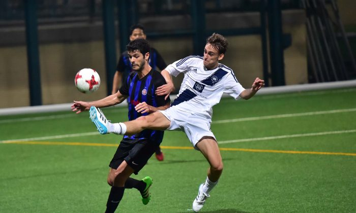 A competitive battle between Club Colts and French Kiss in Division 1 of the Yau Yee League ended in a 1-1 draw at Sports Road on Sunday Oct 29, 2017. (Bill Cox/Epoch Times)