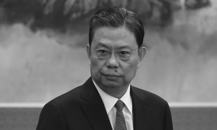 Zhao Leji, Secretary of the Central Commission for Discipline Inspection (CCDI), stands as he is introduced as a new member of the Communist Party of China's Politburo Standing Committee, in Beijing on Oct. 25, 2017. (Wang Zhao/AFP/Getty Images)