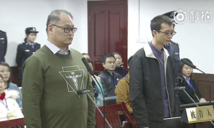 Screenshot taken from a video released by the Intermediate People's Court of Yueyang. Taiwanese activist Lee Ming-che (L) and his fellow defendant Peng Yuhua of China stand during their sentencing at the court on Nov. 28, 2017. (Screenshot via Intermediate People's Court of Yueyang)