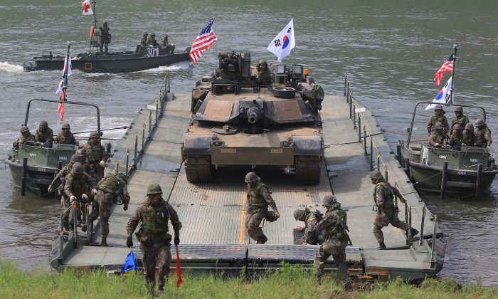 U.S. Army soldiers and a U.S. M1A2 tank and South Korean soldiers  participate in a river crossing exercise on May 30, 2013 in Yeoncheon-gun, South Korea. The joint exercise is one of several the two countries have held in recent months. (Chung Sung-Jun/Getty Images)