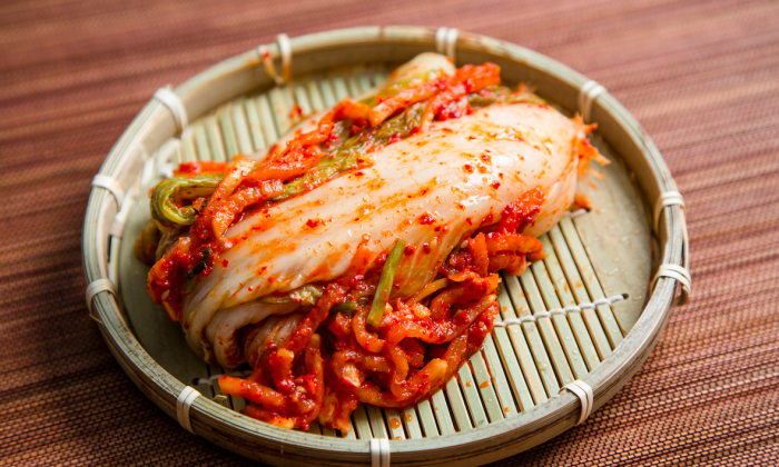 Kimchi is a popular Korean side dish eaten with many meals. It is made from fermented cabbage and spices, with many possible variations. (Samira Bouaou/The Epoch Times)