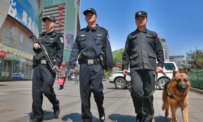 Armed police officers patrol a street in Beijing, China on May 12, 2014.  (VCG/VCG via Getty Images)