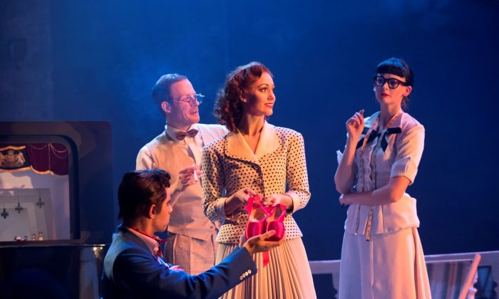 """Ashley Shaw (center) as Victoria Page, surrounded by the company, in """"The Red Shoes."""" (Johan Persson)"""