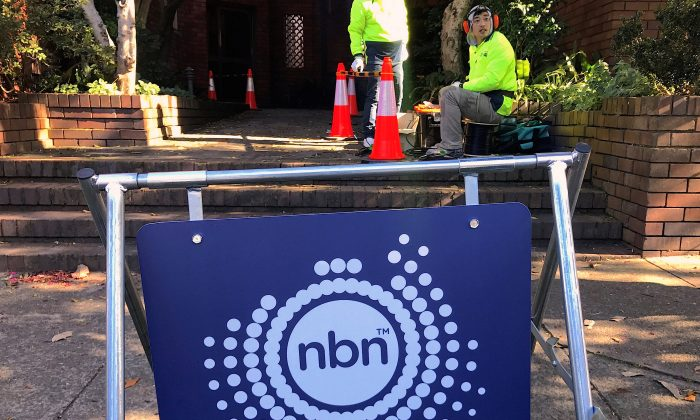 Workers install cables for the Australian National Broadband Network (NBN) at an apartment block in Sydney, Australia, May 30, 2017. (Reuters/David Gray /File Photo)