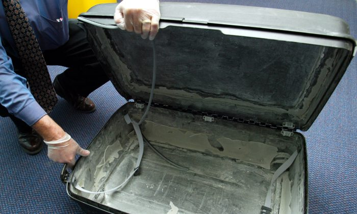 This suitcase was used to smuggle 15 lbs. of cocaine into New Zealand—a very small haul compared to the 200 lbs Isabelle Lagace and her two companions tried to sneak into Australia.  (Michael Bradley/Getty Images)