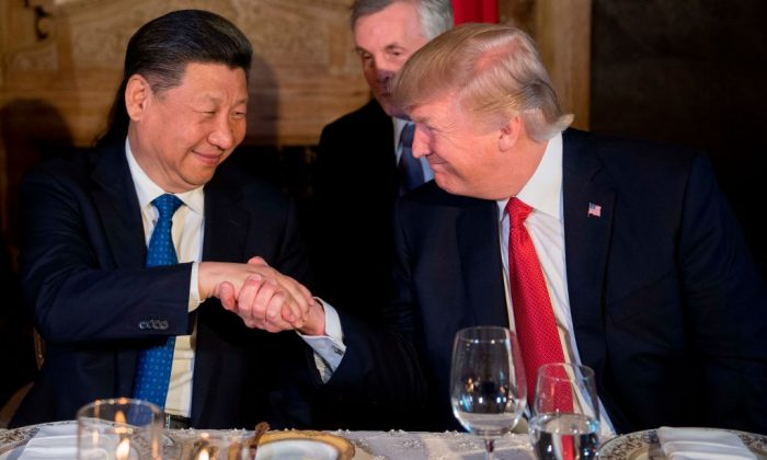 President Donald Trump and Chinese leader Xi Jinping shake hands during dinner at the Mar-a-Lago estate in West Palm Beach, Florida, on April 6, 2017. (Jim Watson/AFP/Getty Images)