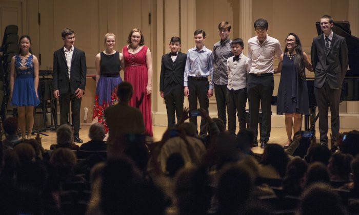 The New York Concerti Sinfonietta presented its 2017 International Shining Star Competition winners to a sold-out audience and introduced Conor Palliser as conductor at Carnegie Hall's Weill Recital Hall on Oct. 29. (L–R), Tiffany Qiu, piano;  Kevin Jansson, violin and piano;  Zoë Nagle, cello; Ellen Jansson, piano; David Blake, cello; Oliver Neubauer, violin; Eoghan Doody, guitar; Gerry Yang, piano; David Tobin, violin; Julie Jordan, founder and artistic director; and Conor Palliser, conductor. (James Eden)
