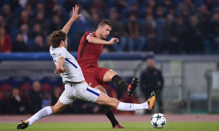 Roma's Bosnian striker Edin Dzeko (R) kicks the ball next to Chelsea's Spanish defender Marcos Alonso during the UEFA Champions League football match AS Roma vs Chelsea on October 31, 2017 at the Olympic Stadium in Rome. (Filippo Monteforte/AFP/Getty Images)