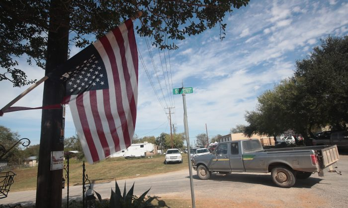An American flag hags upside down from a home near the First Baptist Church of Sutherland Springs in Sutherland Springs, Texas on Nov. 6, 2017. On Nov. 5 a gunman, (Scott Olson/Getty Images)