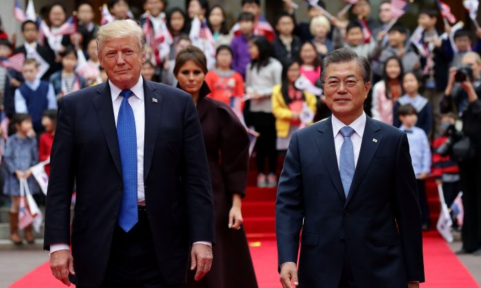 President Donald Trump and South Korean President Moon Jae-In walk towards a guard of honor during a welcoming ceremony at the presidential Blue House in Seoul on Nov. 7, 2017. (Chung Sung-Jun/Getty Images)