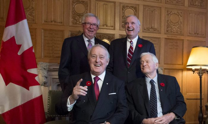 Former prime ministers Brian Mulroney (front L) and John Turner, with Joe Clark (rear L) and Paul Martin as they mark the 150th anniversary of the first meeting of the first Parliament of Canada, in Ottawa on Nov. 6, 2017. (The Canadian Press/Justin Tang)