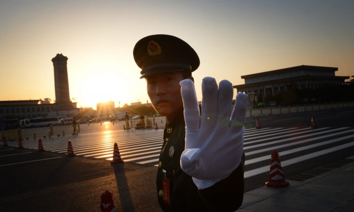 A Chinese paramilitary policeman reacts outside the opening session of the Chinese Communist Party's five-yearly Congress at the Great Hall of the People in Beijing on Nov. 8, 2012. (MARK RALSTON/AFP/Getty Images)