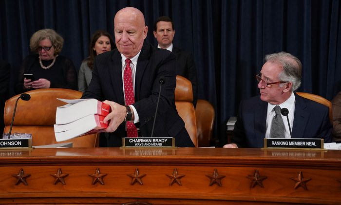 House Ways and Means Committee Chairman Kevin Brady (R-Texas) (L) sets down a copy of the current tax code as he and ranking member Rep. Richard Neal (D-Mass.) prepare for the first markup hearing of the proposed GOP tax reform legislation in the Longworth House Office Building on Capitol Hill in Washington, on Nov. 6, 2017.  (Chip Somodevilla/Getty Images)