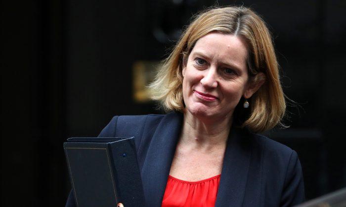 Amber Rudd, Britain's Home Secretary, leaves 10 Downing Street in London, Britain, Oct. 17, 2017. (REUTERS/Hannah Mckay)