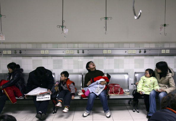 Parents hold children who are being given infusions at an area hospital in Wuhan, Hubei Province, in this file photo. (China Photos/Getty Images)