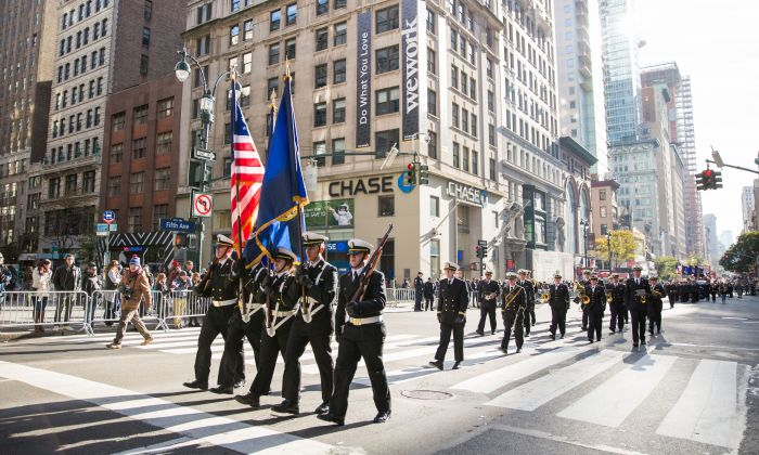 Soldiers, veterans and civilians march in the Veterans Day Parade in New York on Nov. 11, 2017. The parade is the the largest Veterans Day event in the nation, as this year's parade featured thousands of marchers from military units, civic and youth groups, businesses and high school bands from across the country and veterans of all eras. (Benjamin Chasteen/The Epoch Times)