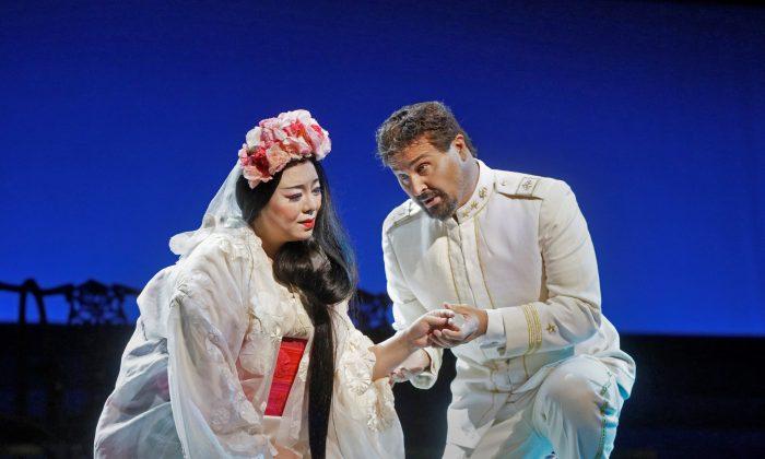 "Hui He as Cio-Cio-San and Roberto Aronica as Pinkerton in Puccini's ""Madama Butterfly.""  (Ken Howard/Metropolitan Opera)"