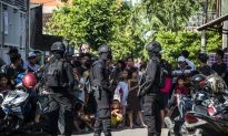 Suspected Indonesian Radicals Armed With Bows and Arrows Burn Down Police Complex