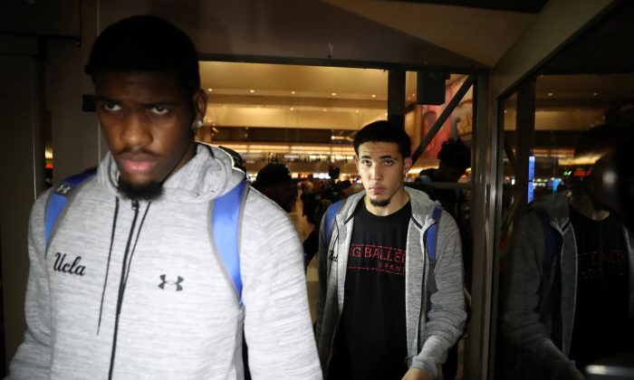 UCLA basketball players LiAngelo Ball (R) and Cody Riley arrive at LAX on November 14, 2017. (REUTERS/Lucy Nicholson)