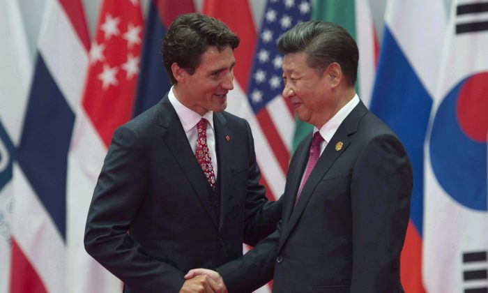 Canadian Prime Minister Justin Trudeau is greeted by Chinese President Xi Jinping at the G20 Leaders Summit in Hangzhou, China on Sept. 4, 2016. (The Canadian Press/Adrian Wyld)