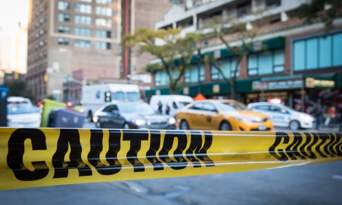 A stock photo of police tape (Benjamin Chasteen/The Epoch Times)