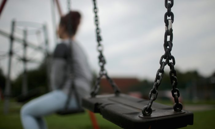 A teenage girl, who claims to be a victim of sexual abuse and alleged grooming, in Rotherham on Sept. 3, 2014. (Christopher Furlong/Getty Images)