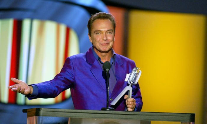"""Actor David Cassidy accepts his Hippest Fashion Plate, Male award for """"The Partridge Family"""" during the TV Land Awards 2003 at the Hollywood Palladium in Hollywood, Calif., on March 2, 2003. (Kevin Winter/Getty Images)"""