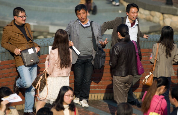 Single men and women gather to chat as thousands of Chinese unmarried people gather at a singles fair organized by a wedding planning agency, to look for their potential mates in Shanghai on Nov. 12, 2011. (STR/AFP/Getty Images)